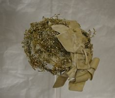 Hat decorated with artificial heather. Collection: Harrogate Museum/Royal Pump Room.