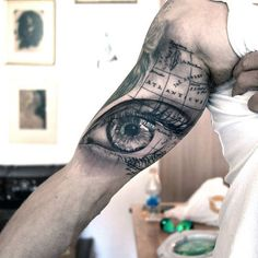 Eye And World Map Tattoo For Males