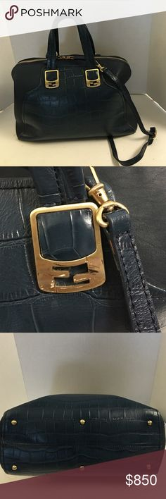 Authentic Fendi croc embossed Chamaeleon satchel This is a gently used authentic Fendi Chamaeleon 2 way  satchel.  Croc embossed Dark blue. Has brushed gold signature hardware. Detachable 21 inch shoulder strap. Double handles. Double zipper closure. Inside lining is signature stripe to print. Has middle zipper compartment and two outside large compartments. Two slip pockets. Very clean inside and out. Just has a very light wear to one corner and scratches to hardware.  Does not include dust…