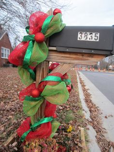 Deco mesh Christmas garland (( wanna put this on the wood pilars out front! ))