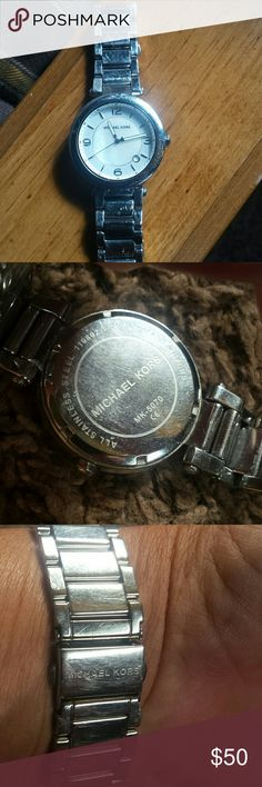 Mk watch used still alot of life left Needs battery but still good watch Michael kors has scratches it's used so price reflects   but wearing it still looks good great deal  man or women watch Michael Kors Accessories Watches