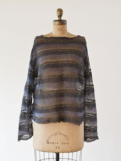KIT-111  Mohair Steel Pullover By Setsuko Torii  This is a very unisex pullover top. Very oversized. Unusual yarn combination of silk, wool stainless steel, mohair and picot!   Original yarn by AVRIL.  content: wool stainless steel, mohair & silk