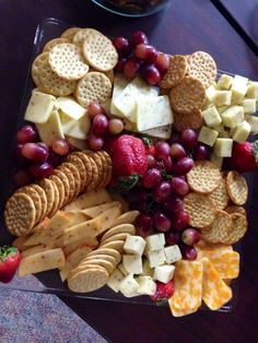 Fruit Cheese platter- Square glass display with different shapes and sizes of cut up cheese