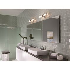 The Payne and Payne Ornate bathroom lighting collections includes a bathroom ceiling light and matching wall lights. These are elegantly designed bathroom light fittings with a hint of Art Deco styling that work in both modern and traditional bathrooms. The lights are manufactured in the USA and the clean white opal etched glass compliments the spun chrome metal rings beautifully.