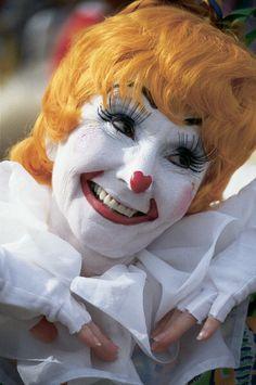 Clown with orange hair at the Annual Circus Paradein Sarasota Florida