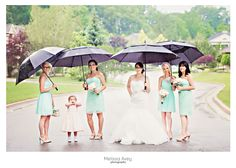 Rainy wedding party photo by Melissa Avey Photography taken in Ancaster , Ontario outside of the Ancaster Mill. #wedding #rain