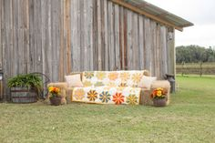 Real Weddings: Ashlei & Steven in Plant City, FL | Welcome haybale couch, Grandma Welch's pinwheel quilt, great photo opportunity