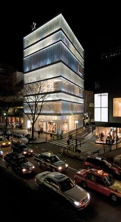 Christian Dior Building by Sanaa in Tokyo materials interact with light makes the whole buidling an elegant dress