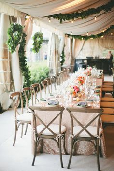 Decorate your wedding tent with lights and garland.