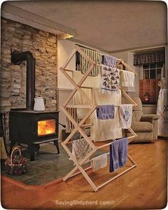 """The perfect place for wet clothes to """"hang out"""" after sledding & snowball fights! ❄️ Many styles & sizes available at SavingShepherd.com or AmishRacks.com  #Amish #handmade #clothes drying racks  #MadeInAmerica"""