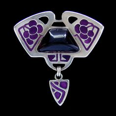 Levinger & Bissinger silver and enamel brooch set with a large cabochon amethyst. Germany, ca. 1900.