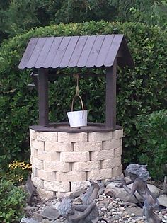Wishing well made with recycled fencing and garden border bricks.