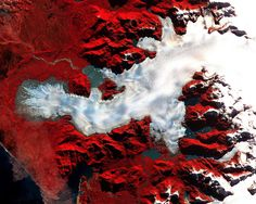 This image of a Patagonian glacier was aqcuired by the Advanced Spaceborne Thermal Emission and Reflection Radiometer (ASTER) on May 2, 2000. Patagonia is a mountainous region spanning the border between Chile and Argentina near the southern tip of South America. The image covers an area of 36 x 30 km—the full-size image has a resolution of 15 meters per pixel. Vegetation appears red in the image, which is a false-color composite of near-infrared, red, and green light displayed as red…