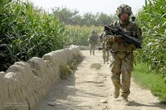 A soldier armed with an SA80 with Underslung Grenade Launcher (UGL) leads a patrol in Afghanistan.