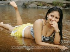 http://www.smartrena.com/in-wet-dress-tamil-sexy-actress-amrutha/