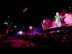 """U2 performs a remixed, dance-y """"I'll Go Crazy If I Don't Go Crazy Tonight"""" at the Rose Bowl during their 360 Tour.  Brings back memories of U2 360 in Denver :)"""