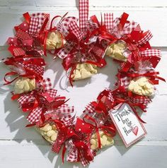 Heartwreath: Do it yourself ribbon tie ring- shape metal hanger into a heart, tie with multiple ribbons, also hang small cellophane bags of little shortbread hearts.