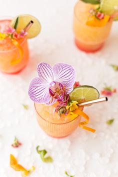 This beach wedding cocktail looks amazing - Caribbean Rum Punch with a purple orchid garnish!