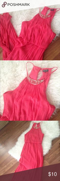 Coral Pink Dress with Gold Detail Pretty coral pink orange Maxi dress with gold detail at neck. This travels really well. Only worn once! It has a shorter lining with the longer flowing skirt that gives it the Maxi length. Small slit in the back Lilly Rose Dresses Maxi