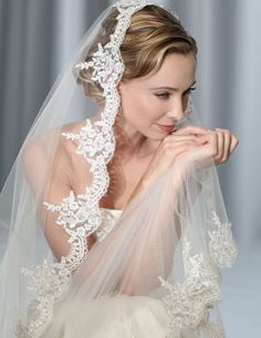 Bel Aire mantilla veil with Alencon lace.