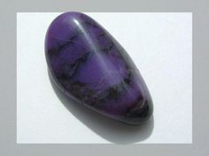 Sugilite or luvulite is an uncommon pink to purple cyclosilicate mineral. - Simon Eugster