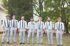Vest for the groom and suspenders for the groomsmen... amazing, except... there should be BOWTIES instead of neckties