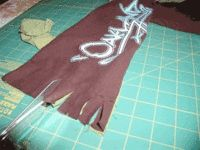 Upcycle 2 tshirts into a scarf.