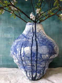 This very large vase is handmade using small coils of porcelain. No other like it is made and no one likely will be. It's very organic in form...