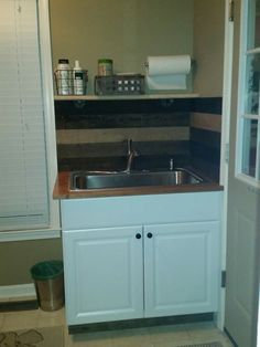 Finally finished our doggy wash station/utility sink area.  Dogs fit great in the 33x25 sink!  Love the kohler laundry faucet!