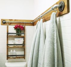 This easy DIY by Ana White uses galvanized pipe to create a cute and practical hanging system for the bathroom.