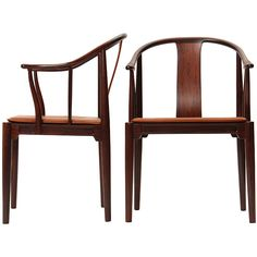 """Pair of rosewood Chinese Chairs by Hans J. Wegner  Denmark  1960's  A rosewood """"Chinese"""" chair with leather seat pad. Design Hans Wegner manufactured by Fritz Hansen."""