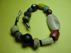 Challenge bracelet. 14 ancient glass and stone beads by GODBC