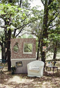 Love this idea of wedding photobooth. Wallpapers behind wall. Frames with a hole where people can pose behind it. A single sofa with a side table. Plus I want to add a black board that serves as an inbox, where they can put dedications/msgs on it.