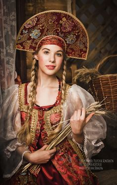 """À la russe. Girl in a stylized Russian costume and """"Kokoshnik"""", a headdress."""