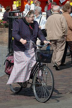 A lady from Bunschoten-Spakenburg (close to Amersfoort) on her bike, in tradition costume.