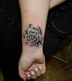 Black and white rose with fantastic shading. I wouldn't do it, but I think it is really pretty