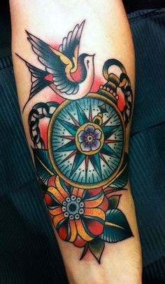 I want a traditional compass tattoo with a banner under it saying  (go your own way)