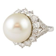 HARRY WINSTON Pearl Diamond and Platinum Ring USA estate dinner ring by Harry Winston. This platinum made ring features a beautiful cultured pearl of 16 mm diameter, with diamonds around the pearl and pave-set at the sides of the ring. I Love Jewelry, Pearl Jewelry, Jewelry Rings, Jewelry Accessories, Vintage Jewelry, Fine Jewelry, Jewelry Design, Pearl Rings, Jewlery