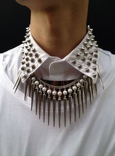 This may be called Nu-Goth Fashion, but I'd rather say Hipster borrowed studs and spikes. Lose the dopey white blouse and add the spikes to a black tank, or blouse and then maybe they'll work.
