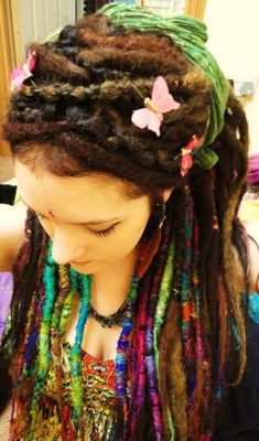 natural colored dreads with what looks like brightly colored and wrapped ends – very pretty!