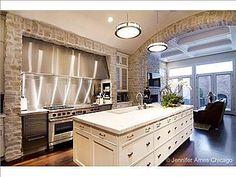 De Giulio chefs kitchen with barrel ceiling, commercial appliances, island, built-in banquet.