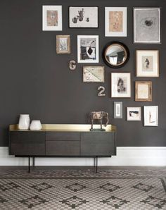 Effective use of prints on a feature wall, we like the black & white with copper colour scheme