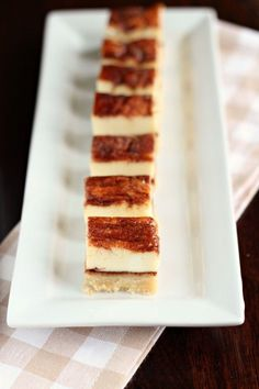 Churros cheesecake bars have a shortbread crust with a cheesecake filling. Bite-sized squares make this dessert easy to serve to a crowd.