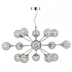 feature Lighting a large crystal modern light for tall ceilings.