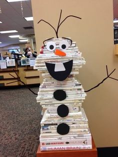 One of our reference librarians shared with me a picture of a snowman book stack she saw at http://iworkatapubliclibrary.com/image/105500093602, and it's so cute, I had to make one at our library. Hap