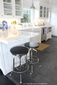 Classic and casual #kitchen - love that end space for stools!