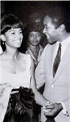 In the last picture before he was fatally shot, singer Sam Cooke chats with Miss Omega Sims during the intermission of the Ebony Fashion Fair in LA. Jet Magazine Dec. 1964