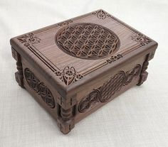 Flower of Life - Small Jewelry Box with carved oriental and arabesques ornaments and motifs made of selected wood (American walnut), inside is upholstered in white velvet. Outside is varnished with environmentally friendly polyurethane resins. Brass hardware adds an elegant finishing touch to the whole design.    Dimensions:  width 19 cm  length 26 cm  height 14 cm  all size are within +/- 0.5 cm    It can be done in different wood, finishing and size on request.  Can be chosen different...
