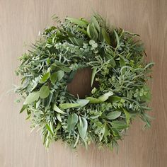 4 Holiday Home Decor Trends for 2015    Holiday Home Decor Trend: Natural elements, like this mixed eucalyptus wreath. #TheSofaCompany