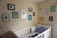 Our nursery gallery wall! So easy to do on a budget! List of art works too!  www.woodenflamingo.com